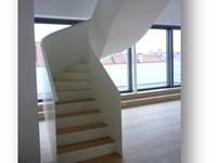 Wendeltreppe in einer Eigentumswohnung in München